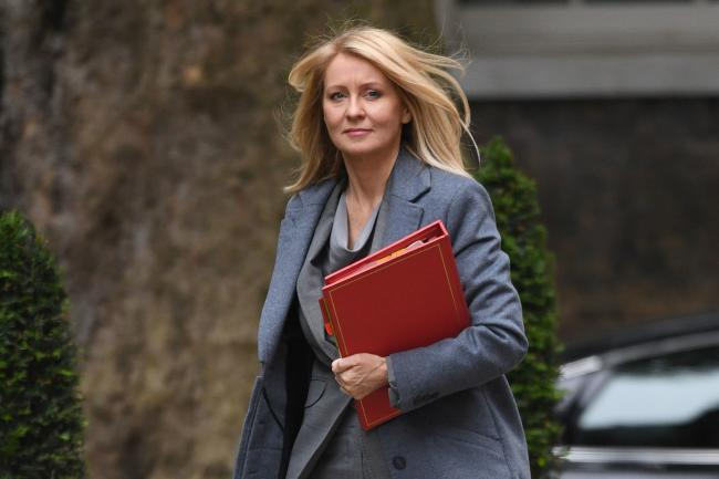 Esther McVey with a red folder