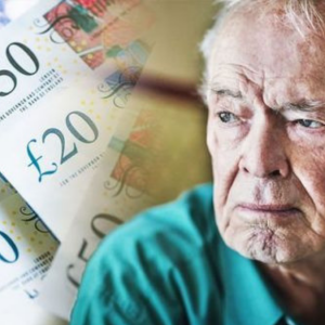 Pensioner looking worried with money